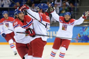 Czech Republic's Roman Cervenka and Czech Republic's Jaromir Jagr celebrate a goal during the Men's Ice Hockey Play-offs Czech Republic vs Slovakia at the Shayba Arena during the Sochi Winter Olympics on February 18, 2014.   AFP PHOTO / JUNG YEON-JEJUNG YEON-JE/AFP/Getty Images
